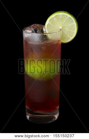 El Diablo Drink, consisting of tequila, creme de cassis, ginger ale and lime juice. Isolated on black background