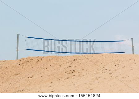 Beach Volley Net On Sand Dune With Sky.