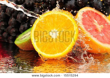 Pure fruit in a spray of water isolated on a white background.