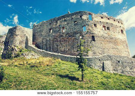 Ruin castle of Topolcany Slovak republic central Europe. Ancient architecture. Beautiful place. Retro photo filter. Travel destination.