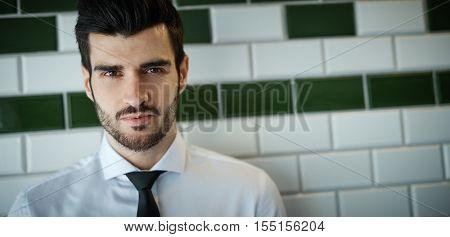 Closeup portrait of confident young man looking at camera.