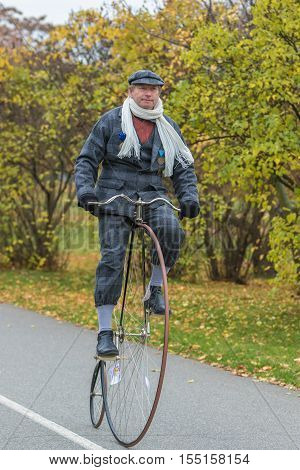 PRAGUE CZECH REPUBLIC - NOVEMBER 5 2016: Unidentified male participant in high wheeler race