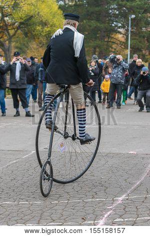 PRAGUE CZECH REPUBLIC - NOVEMBER 5 2016: Unidentified participant in high wheeler race