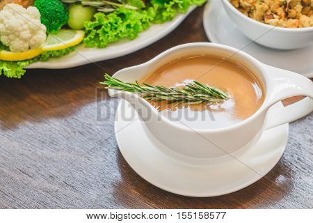 Close up of Gravy sauce on Christmas Dinner table