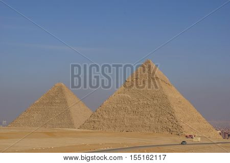 A view on the Giza Pyramid Complex From the desert to the city of Cairo