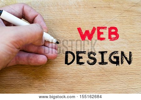 Human hand over wooden background and web design text concept