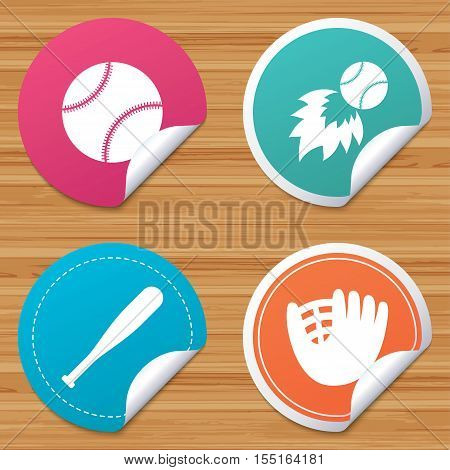 Round stickers or website banners. Baseball sport icons. Ball with glove and bat signs. Fireball symbol. Circle badges with bended corner. Vector