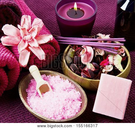 pink Spa tools with candle amd towel
