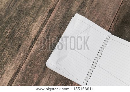 paper notebook crumpled on wooden table business concept