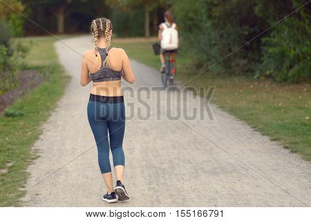 Young Woman Out Jogging In A Path
