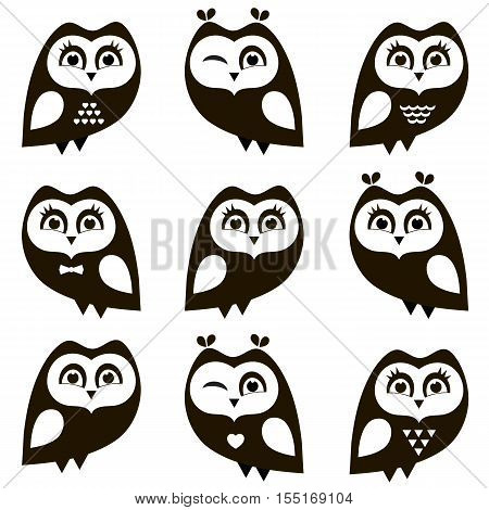 Black and white owls and owlets isolated on white