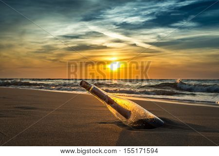 Ancient Message In A Bottle On A Sea Shore