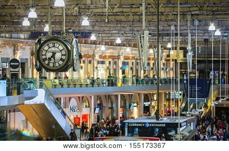 LONDON UK - 19 DECEMBER, 2015: Waterloo international train station in the centre of London, one of the main rail junction of Great Britain Departure hall with lots of people