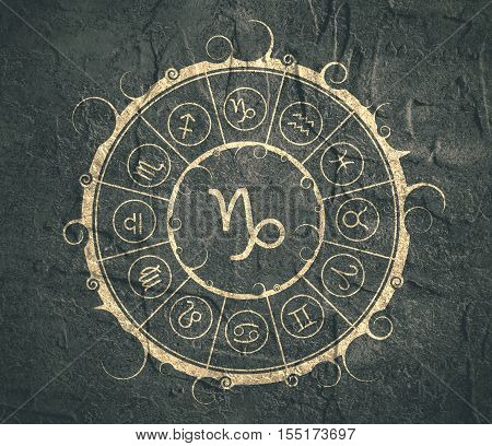 Astrological symbols in the circle. Concrete wall textured. Capricorn sign
