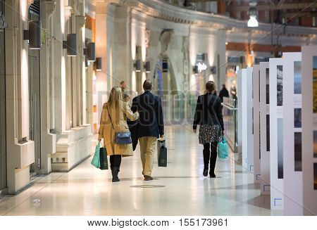 LONDON UK - 19 DECEMBER, 2015: People in the shopping gallery of the Waterloo train station