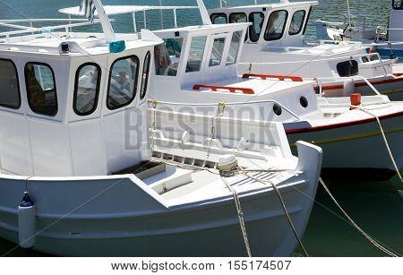 Greece Crete fishermen boats in the Iraklio harbor