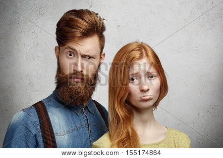 Relationships Problems Concept. Beautiful Redhead Young Woman Pouting Her Lips, Looking Upset And Un