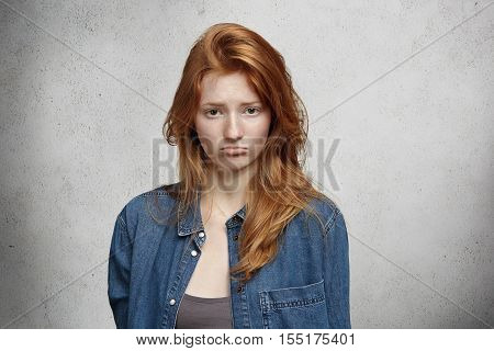 Human Face Expressions And Emotions. Portrait Of Pretty Teenage Girl With Long Red Hair And Freckles
