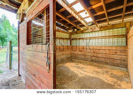 Empty Stable In Wooden Horse Barn.