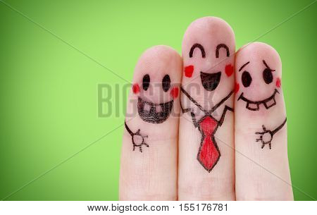 Fingers with happy smiley face on green background
