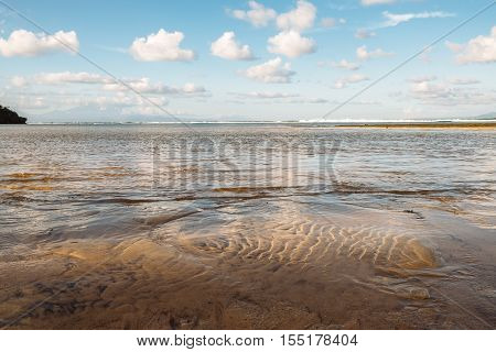 Shallow sea with sand spits at sunset time on the Gulf of Finland near St. Petersburg, Russia