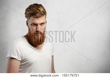 Portrait Of Masculinity. Handsome Young Bearded Hipster Man With Stylish Haircut Looking Serious Or