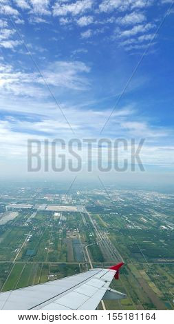 Wing Of Airplane, Green Land And Blue Sky