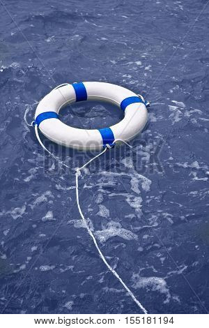 Buoy lifebelt lifesaver floating in blue ocean as help equipment
