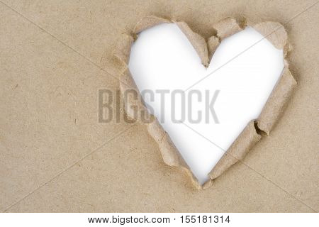 Recycled paper torn through in heart shape
