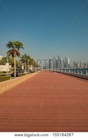 DUBAI, UAE - OCTOBER 11, 2016: The Boardwalk on the Palm Jumeirah Island on the Crescent.  The Palm Jumeirah is an artificial archipelago created using reclaimed land