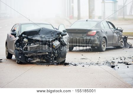 Car crash accident on street with wreck and damaged automobiles after collision