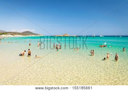 Chia Italy - August 18 2016: The wonderful beaches and crystal clear water of bay Chia Sardinia Italy.