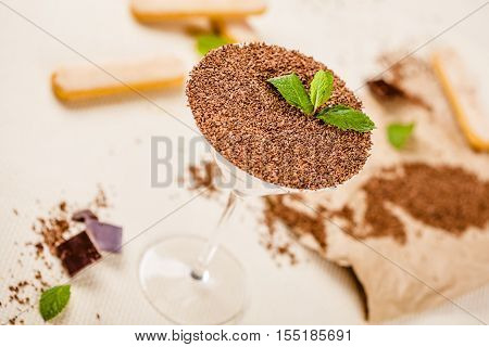 Dessert Tiramisu in a glass on table