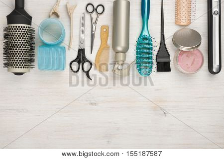 Professional hairdressing tools and accessories with copyspace at the bottom