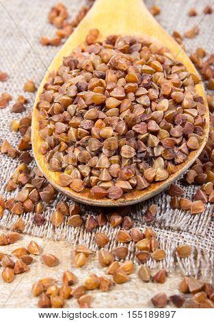 Buckwheat Groats On A Wooden Spoon.