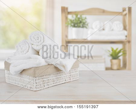 Spa towels on wood over abstract beauty salon room background