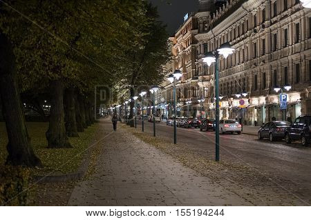 HELSINKI , FINLAND - OCTOBER 13, 2016: The Esplanade by night in the city center of Helsinki. Helsinki is the capital of Finland.