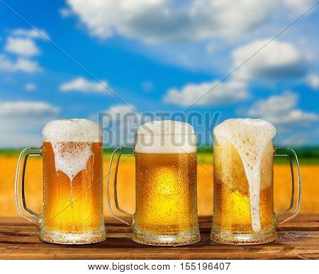 cold glass mug of beer in a landscape