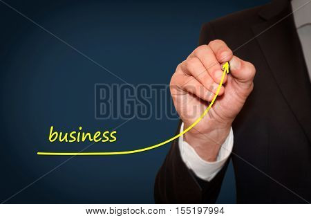 Businessman drawing increase Business graph motivation concept. Business plan to accelerate business growth.
