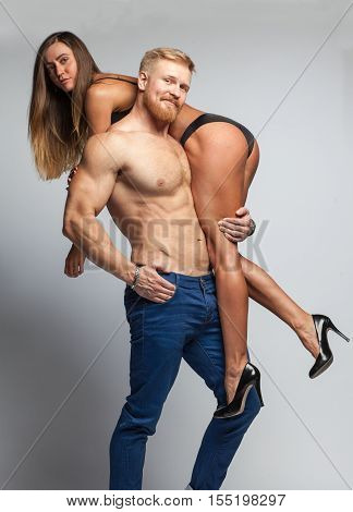 Strong Bearded Man Hold Up Sexy Woman In Lingerie