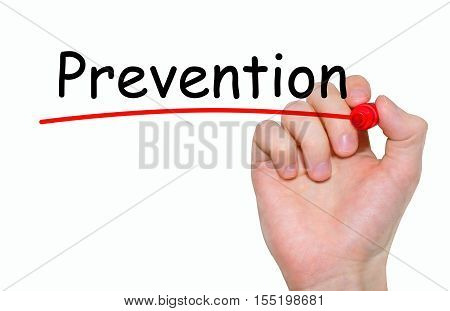 Hand writing Prevention with red marker on transparent wipe board.