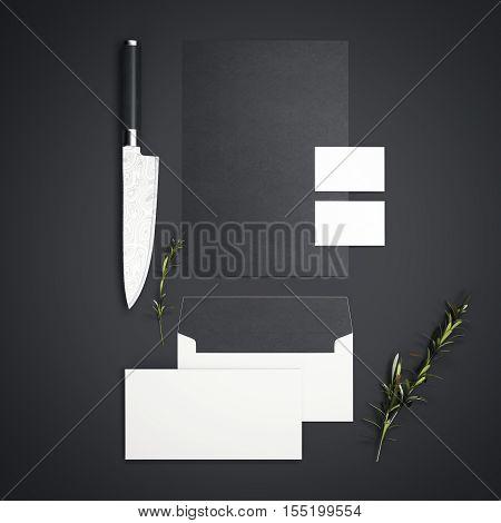 Branding restaurant mockup with sharp knife on dark floor. 3d rendering