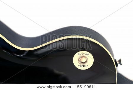 Part of vintage electric guitar black color with arc top isolated on white background vertical view closeup