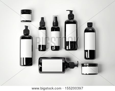 Set of black beauty cosmetic plastic containers on a white floor. 3d rendering