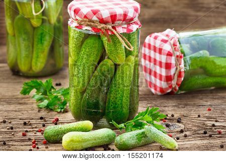 Homemade pickles in brine, Jar of homemade Pickled Gherkins