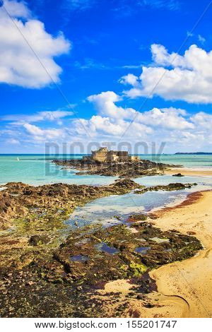 Saint Malo beach Fort National and rocks during Low Tide. Brittany France Europe.