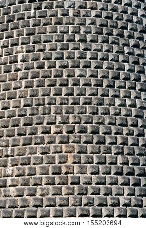 Detail of a rustication wall with gray stones hand carved (ashlar wall). Castello Sforzesco (Sforza Castle) Milano Lombardy Italy