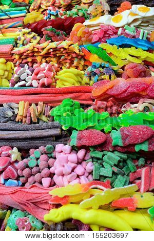 Assorted Colorful Candies and sweets in a market. La Boqueria the most famous market in Barcelona