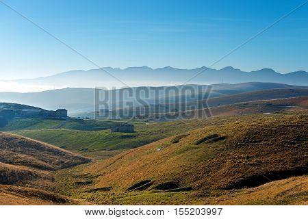 Plateau of Lessinia Regional Natural Park of Lessinia Veneto Verona Italy. In the background the Italian Alps (Monte Baldo - Baldo Mountain)
