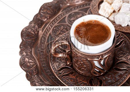 Traditional cup of Turkish coffee with foam and Turkish delights isolated on white background. poster